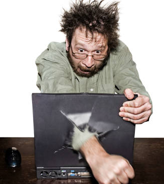 Wild-haired man punches fist through laptop screen